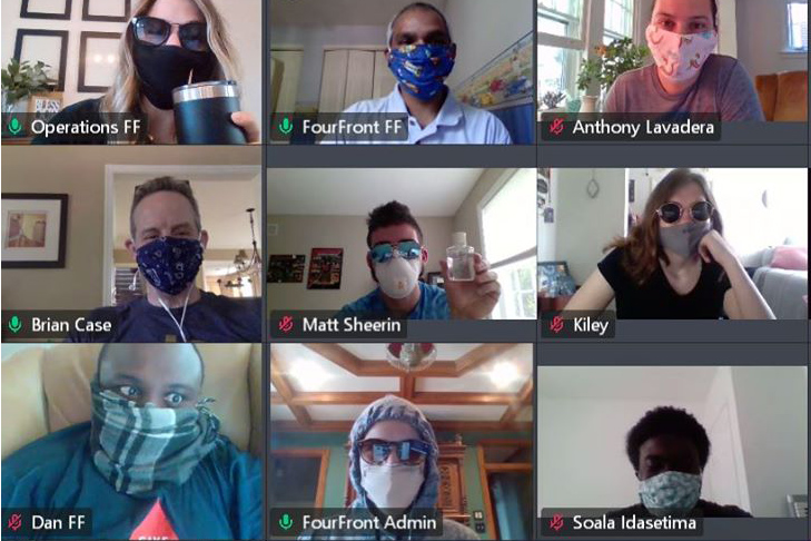 Screenshot of FourFront employees wearing face masks for a video conference